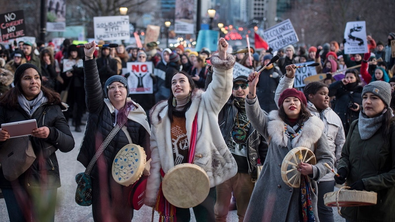 People gather outside of Queen's Park during a Family Day march in support of the Wet'suwet'en hereditary chiefs in Toronto on Monday, Feb. 17, 2020. (Tijana Martin / THE CANADIAN PRESS)