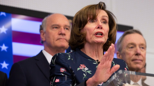 Speaker of the House Nancy Pelosi, D-Calif, center, speaks during a media conference after a meeting at NATO headquarters in Brussels, Monday, Feb. 17, 2020. (AP Photo/Virginia Mayo)