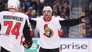 Ottawa Senators defenseman Mark Borowiecki (74) celebrates his goal with teammate Dylan DeMelo (2) during the third period of an NHL hockey game against the Buffalo Sabres, Tuesday, Jan. 28, 2020, in Buffalo, N.Y.  (Jeffrey T. Barnes/AP Photo)