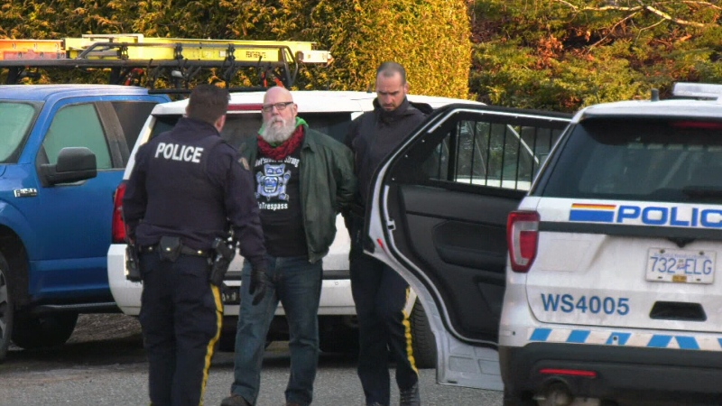 A protester is arrested outside the home of Premier John Horgan on Tuesday, Feb. 18, 2020. (CTV News)
