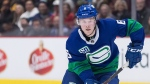 Vancouver Canucks' Brock Boeser passes the puck during the second period of an NHL hockey game against the Calgary Flames in Vancouver, on Saturday, Feb. 8, 2020. (Darryl Dyck / THE CANADIAN PRESS)