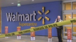 A police officer is seen outside a Walmart in Richmond, B.C. during a standoff on Feb. 18, 2020.