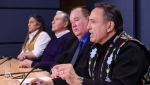 Assembly of First Nations (AFN) National Chief Perry Bellegarde, right, is joined by First Nations leaders as they discusses the current situation and actions relating to the Wet'suwet'en people during a press conference at the National Press Theatre in Ottawa on Tuesday, Feb. 18, 2020. THE CANADIAN PRESS/Sean Kilpatrick