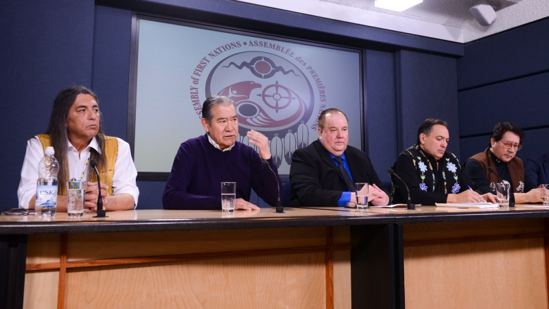 Mohawk Council of Kahnawake Grand Chief Joseph Norton, second from left, is joined by First Nations leaders as they discusses the current situation and actions relating to the Wet'suwet'en people during a press conference at the National Press Theatre in Ottawa on Tuesday, Feb. 18, 2020. THE CANADIAN PRESS/Sean Kilpatric
