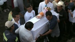 Family members bury 7-year-old murder victim Fatima in Mexico City, Tuesday, Feb. 18, 2020. (AP Photo/Marco Ugarte)