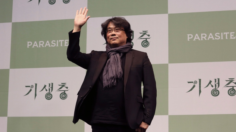 "Bong Joon-ho, director of Oscar-winning ""Parasite,"" waves after a press conference in Seoul, South Korea, Wednesday, Feb. 19, 2020. (AP Photo/Ahn Young-joon)"