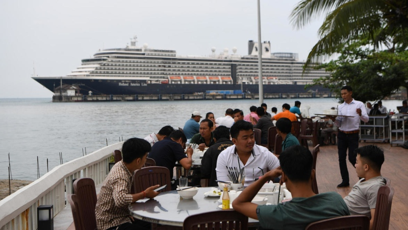 Diners have lunch in the foreground of the Westerdam cruise ship in Sihanoukville, Cambodia. (AFP)