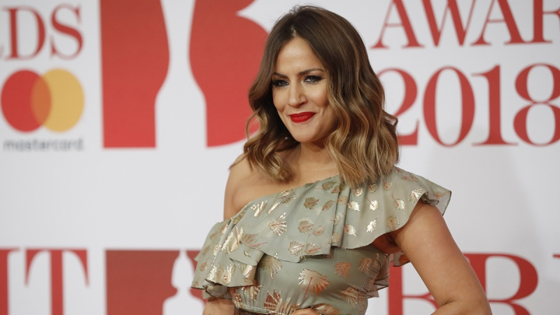 Caroline Flack poses on the red carpet in London on February 21, 2018. (Tolga Akmen / AFP / Getty Images)