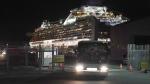 Buses carrying Australian passengers from the quarantined Diamond Princess cruise ship leave a port in Yokohama, near Tokyo, Wednesday, Feb. 19, 2020. (AP Photo/Eugene Hoshiko)