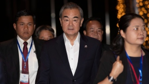 China's Foreign Minister Wang Yi arrives for welcome dinner in Vientiane, Laos, Wednesday, Feb. 19, 2020. (AP Photo/Sakchai Lalit)