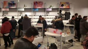 Customers shop for cannabis on the opening morning of Tokyo Smoke in Cambridge.