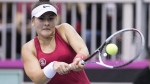 Bianca Andreescu of Canada returns to Lesia Tsurenko of Ukraine during their Fed Cup tennis match in Montreal on April 21, 2018.THE CANADIAN PRESS/Graham Hughes
