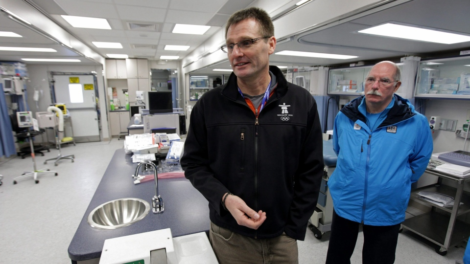 Director of medical services for VANOC, Dr. Mike Wilkinson, left, and mobile unit manager Dr. Ross Brown speak to reporters in a mobile medical unit setup at the Whistler Athletes' Village for the Vancouver 2010 Winter Olympic Games in Whistler, B.C., on  January 20, 2010. THE CANADIAN PRESS/Darryl Dyck