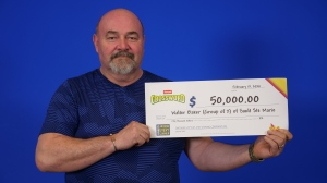 Walter Baker, of Sault Ste. Marie, shares a $50,000 lottery win with his sister Shirley Downes. (OLG)