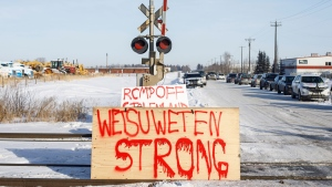Supporters of the Wet'suwet'en who are against the LNG pipeline, block a CN Rail line just west of Edmonton on Wednesday February 19, 2020. THE CANADIAN PRESS/Jason Franson