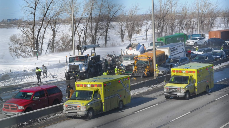 Kyle Bathurst's silver Honda can be seen wedged between the school bus and the barrier in this photo from the crash.