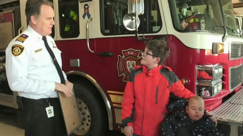 Boy honoured for saving his family from fire