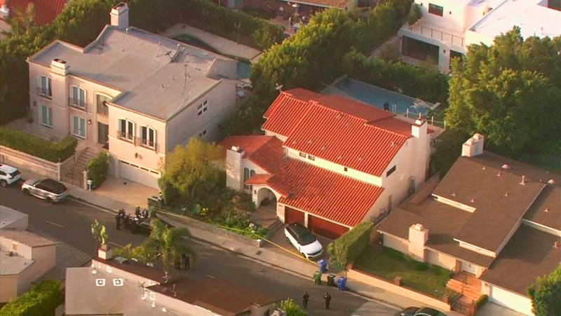 This aerial photo taken from video provided by Fox11 News KTTV-TV shows the Hollywood Hills home, center, where Pop Smoke, 20, was shot and killed early Wednesday, Feb. 19, 2020, in Los Angeles. (Fox11 News KTTV-TV via AP)