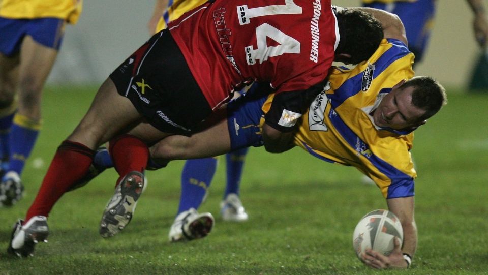 Rowan Baxter is tackled during the NZRL National Premiership Bartercard Cup Grand Final in 2006. (Land/Getty Images AsiaPac/Getty Images)