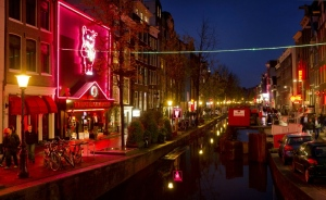 Amsterdam is looking at moving part of its famed red light district (pictured 2011) to an indoor complex that could include a bed and breakfast for prostitutes as well as a sex club, sex theatre and cafes. (AFP)