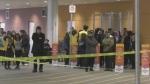 Bystanders linger at dangerous scene
