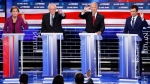 From left, Democratic presidential candidates, former New York City Mayor Michael Bloomberg, Sen. Elizabeth Warren, D-Mass., Sen. Bernie Sanders, I-Vt., former Vice President Joe Biden, former South Bend Mayor Pete Buttigieg, try to answer a question during a Democratic presidential primary debate Wednesday, Feb. 19, 2020, in Las Vegas, hosted by NBC News and MSNBC. (AP Photo/John Locher)