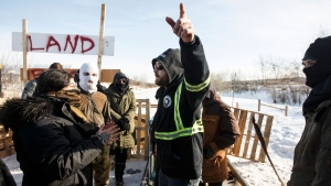 A counter protestor argues with supporters of the Wet'suwet'en hereditary chiefs as they block a CN Rail line just west of Edmonton Alta, on Wednesday February 19, 2020. THE CANADIAN PRESS/Jason Franson
