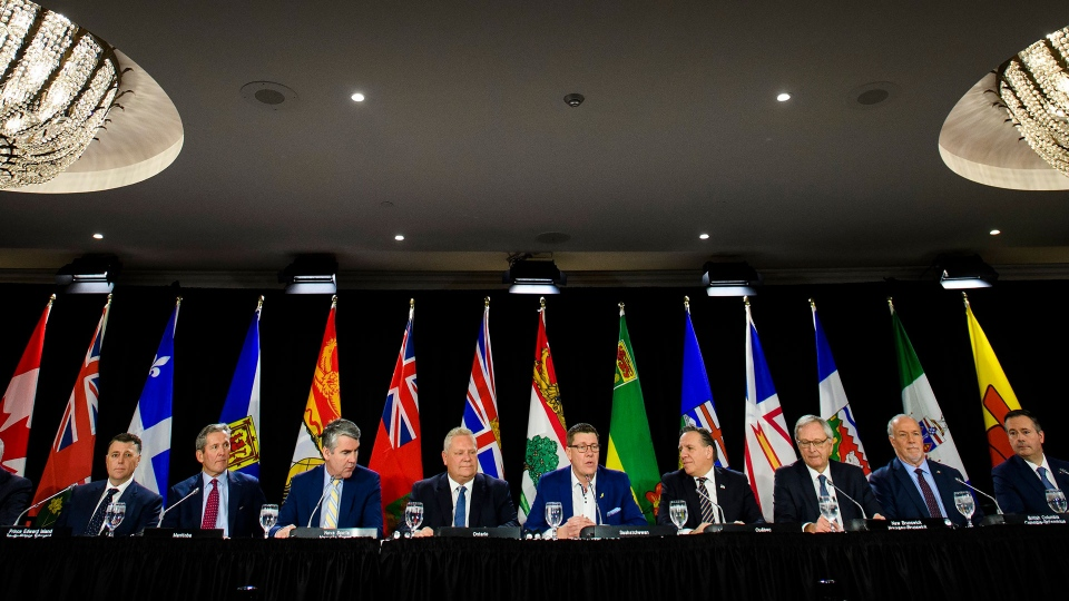 Canadian Premiers speak to the media during a meeting of the Council of the Federation, which comprises all 13 provincial and territorial leaders, in Mississauga, Ont., Monday, Dec. 2, 2019. THE CANADIAN PRESS/Nathan Denette