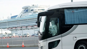 A buse carrying the passengers from the quarantined Diamond Princess cruise ship leaves a port in Yokohama, near Tokyo, Wednesday, Feb. 19, 2020. Hundreds of passengers began leaving the cruise ship Wednesday after the end of a much-criticized, two-week quarantine that failed to stop the spread of a new virus among passengers and crew. (AP / Eugene Hoshiko)