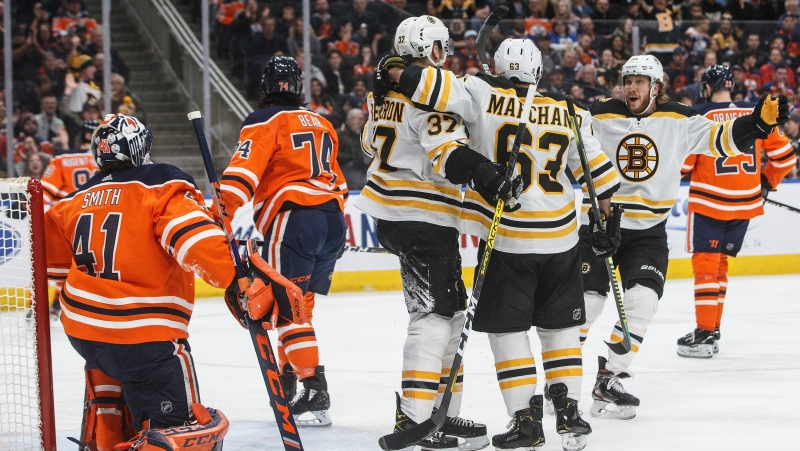 Boston Bruins celebrate a goal against the Edmonton Oilers as goalie Mike Smith (41) looks on during first period NHL action in Edmonton, Alta., on Wednesday February 19, 2020. THE CANADIAN PRESS/Jason Franson