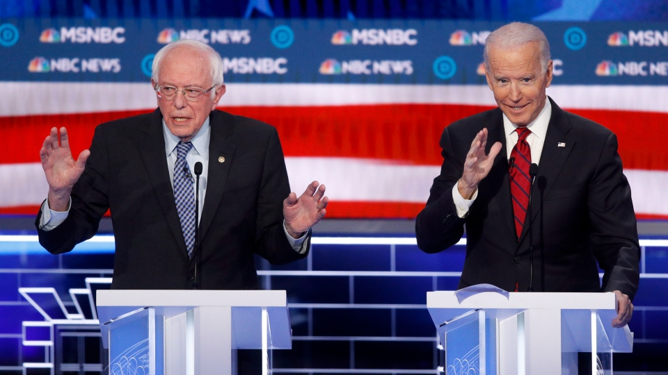 Democratic presidential candidates, Sen. Bernie Sanders, I-Vt., left, and former Vice President Joe Biden gesture during a Democratic presidential primary debate Wednesday, Feb. 19, 2020, in Las Vegas. (AP Photo/John Locher)