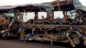 The remains of a Kerala state-run bus that collided head-on with a truck near Avanashi, Tamil Nadu state, India, Thursday, Feb.20, 2020. (AP Photo)