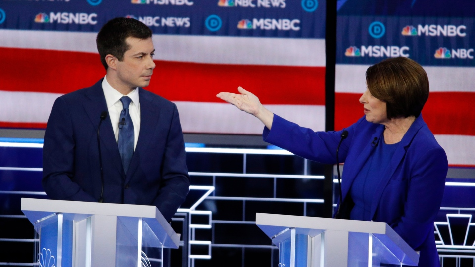 Democratic presidential candidates, Sen. Amy Klobuchar, D-Minn., right, speaks as former South Bend Mayor Pete Buttigieg looks on during a Democratic presidential primary debate Wednesday, Feb. 19, 2020, in Las Vegas. (AP Photo/John Locher)