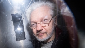 A lawyer for WikiLeaks founder Julian Assange has said that a former U.S. congressman offered him a pardon on behalf of US President Donald Trump, in exchange for denying Russian involvement in the Democratic National Committee email leak. (Dominic Lipinski/PA Wire/AP)