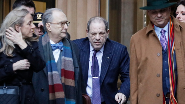 Harvey Weinstein, centre, leaves a Manhattan courthouse during his rape trial, Wednesday, Feb. 19, 2020, in New York. (AP Photo/John Minchillo)