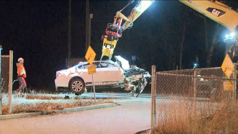 Police are searching for a suspect who abandoned a badly damaged vehicle on GO train tracks early Thursday morning.