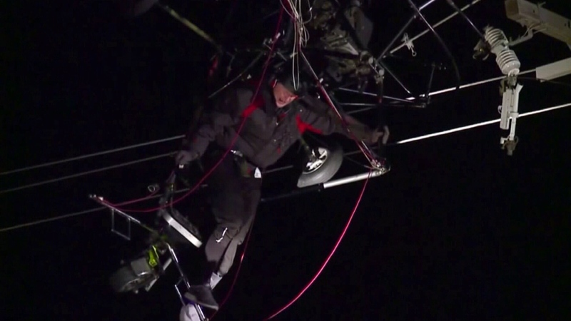 Trapped paraglider rescued from power lines