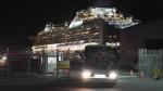 Buses carrying Israeli passengers from the quarantined Diamond Princess cruise ship leave a port in Yokohama, near Tokyo, Thursday, Feb. 20, 2020. (AP Photo/Eugene Hoshiko)
