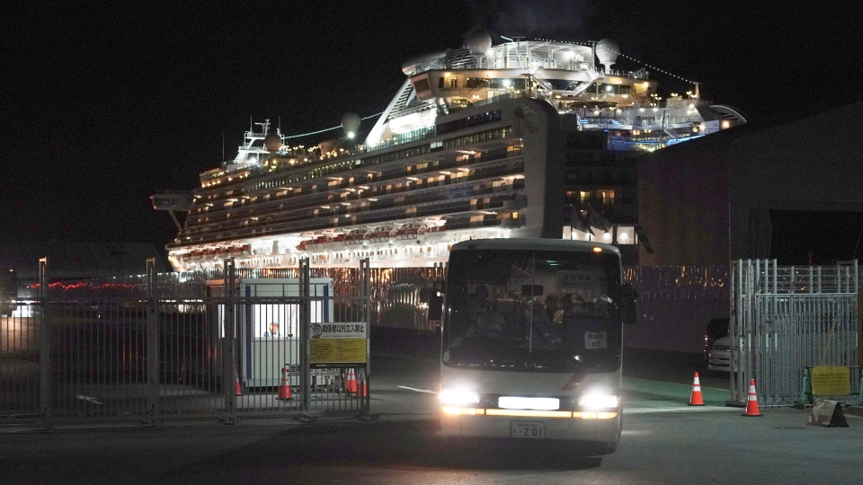 Buses carrying Israeli passengers from the quarantined Diamond Princess cruise ship leave a port in Yokohama, near Tokyo, Thursday, Feb. 20, 2020. (AP Photo/Eugene Hoshiko)