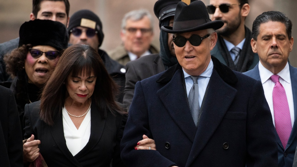 Roger Stone accompanied by his wife Nydia Stone, left, arrives for his sentencing at federal court in Washington, Thursday, Feb. 20, 2020. (AP Photo/Manuel Balce Ceneta)