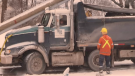 Operator Shannon Stanzel sits in her cab while crews figure out how to safely remove her on Feb. 20, 2020. (Gerry Dewan / CTV London)