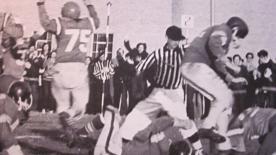 Football game from MacDonald-Cartier yearbook