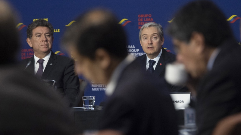 Peruvian Foreign Minister Gustavo Meza Cuadra looks on as Canadian Foreign Affairs Minister Francois-Philippe Champagne delivers his opening remarks at the Lima Group Ministrerial meeting in Gatineau, Que., on Feb. 20, 2020. (Adrian Wyld / THE CANADIAN PRESS)