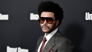 """The Weeknd attends the LA premiere of """"Uncut Gems"""" at ArcLight Hollywood on Wednesday, Dec. 11, 2019, in Los Angeles. (Photo by Richard Shotwell/Invision/AP)"""