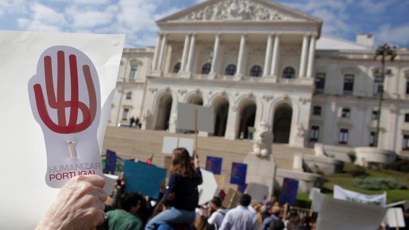 Demonstrators protest outside the Portuguese parliament in Lisbon, Thursday, Feb. 20, 2020. (AP Photo/Armando Franca)