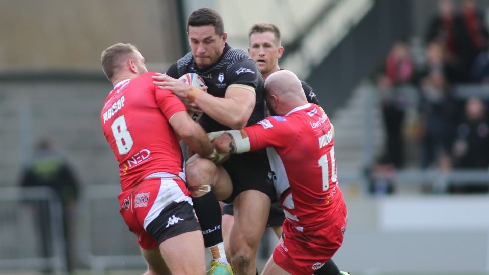 Toronto Wolfpack's Sonny Bill Williams is wrapped up by Salford Red Devils players during Betfred Super League rugby action in Manchester, Eng., Saturday, Feb.8, 2020. (THE CANADIAN PRESS/HO-Steve Gaunt, Touchlinepics Sports and Event Photography)
