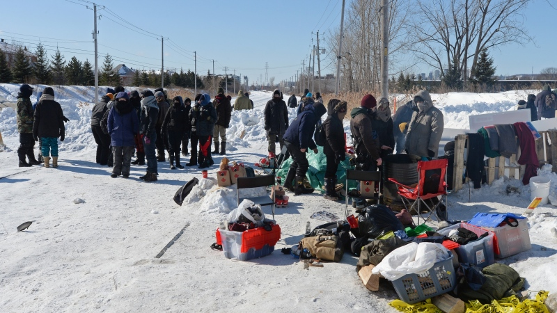 People protest at a rail blockade in St-Lambert, south of Montreal, Que. on Thursday, February 20, 2020 in solidarity with the Wet'suwet'en hereditary chiefs opposed to the LNG pipeline in northern British Columbia. THE CANADIAN PRESS/Ryan Remiorz
