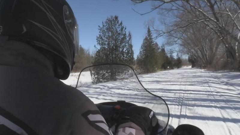 A person rides a snowmobile in this file photo.