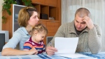 A new poll from Research Co. suggests more than half of B.C. parents are experiencing financial stress. (Shutterstock)