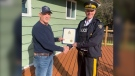 'G.A.' accepts his letter of appreciation from Nanaimo RCMP detachment Supt. Cameron Miller. (RCMP)